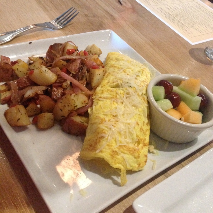 Chef's omelette special with roasted red potatoes and fresh fruit. $10.99