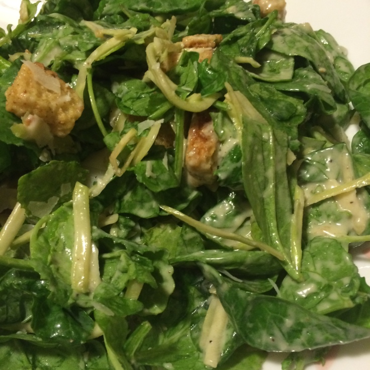 What the kale Caesar salad kit looks like after tossing it up and then pouring on a plate!