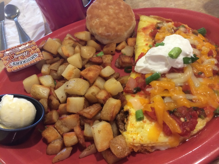 South of the Border omelette with hash browns & biscuit.  $8.79